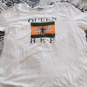 White shirt with queen bee on it